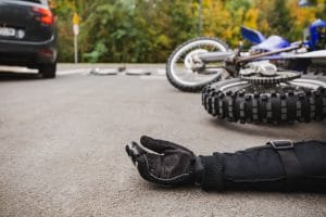 Man on the street after fatal car and motorcycle accident