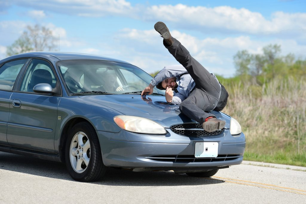 Man Being Hit by Car