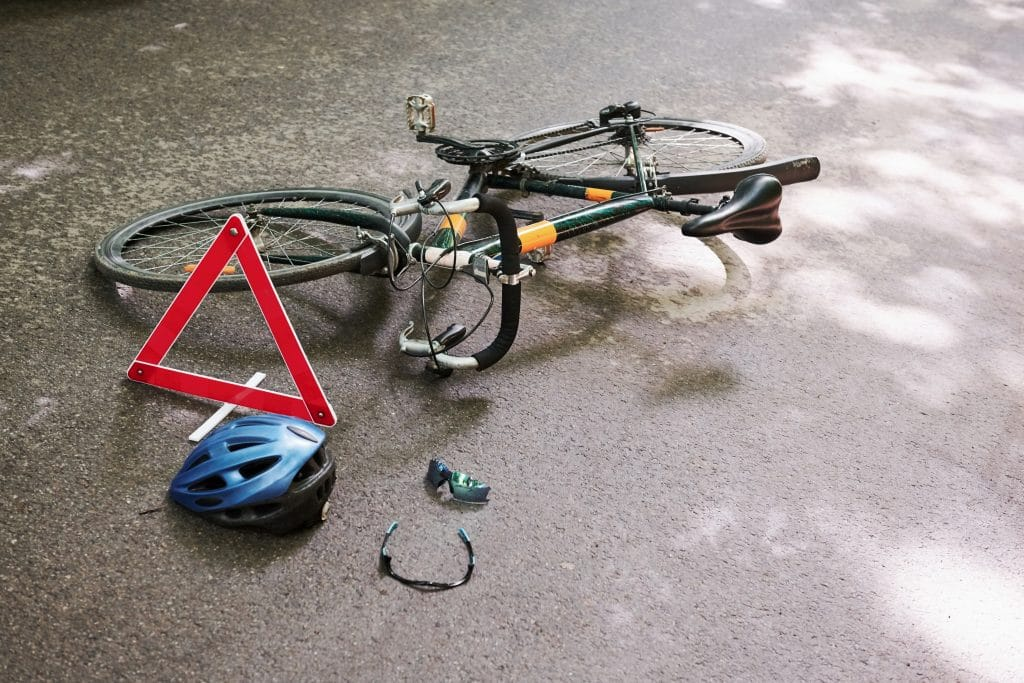 No people. Place of hit. Bicycle accident on the road in forest at daytime.